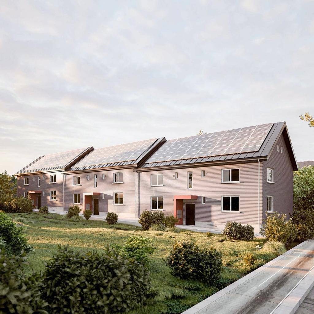 """So sieht es nach Fertigstellung aus: Aus einem 1930er Jahre Gebäude für """"einfache Leute"""" wurde ein zeitgemäßes, komfortables Wohngebäude im Grünen mit niedriger Warmmiete und viel Platz für Familien. Foto: ecoworks"""